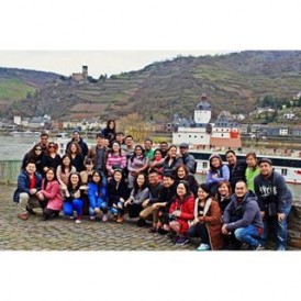 A recent #ExpatExplore Europe Escape tour group in the Rhine Valley, #Germany. In the background you can see Pfalzgrafenstein Castle, a toll castle built in the 14th century. These toll castles were constructed for the sole purpose of generating revenue from boats travelling along the river. Pfalzgrafenstein is one of many toll castles on the Rhine, but its location on a very small island in the middle of the river makes it unique.