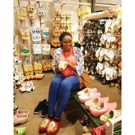 Surrounded by clogs of different shapes, sizes and colours at the Clara Maria cheese and clogs farm in Amsterdam. Photo by @hilda_herself