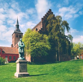 statue of Hans Christian Andersen in front of sct Knud cathedral, Odense Denmark